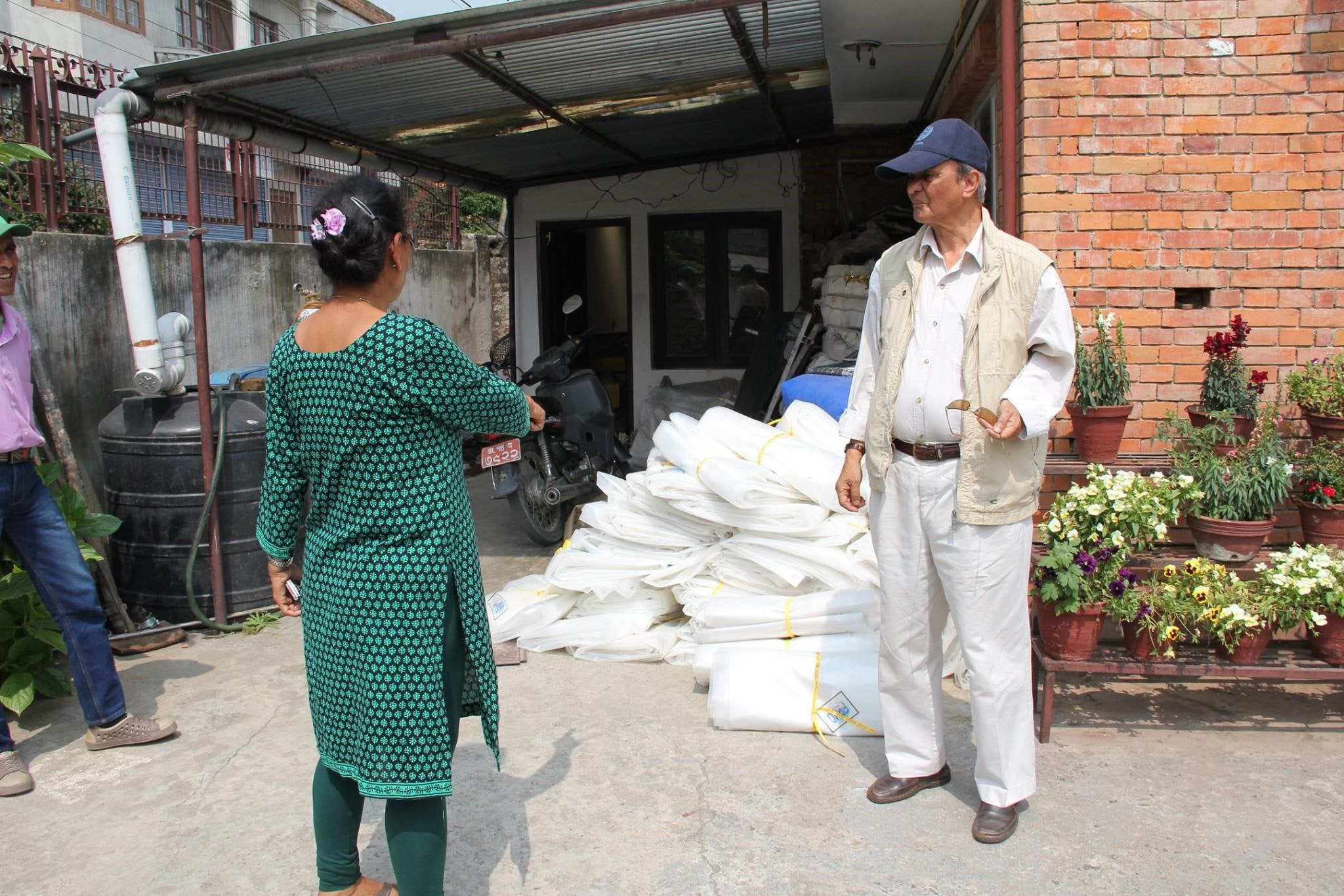 Distribution of Roffing Material by fipmo memeber-min